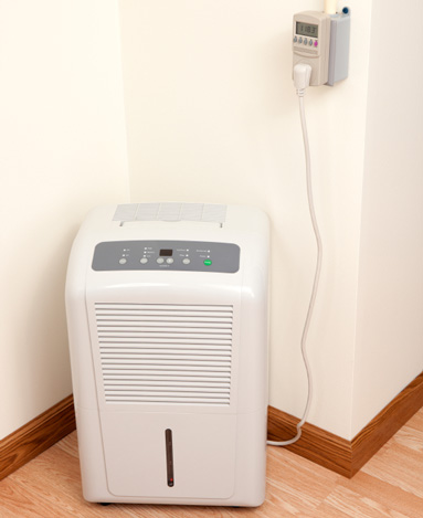 Indoor air dehumidifier operating in a St. Paul home.